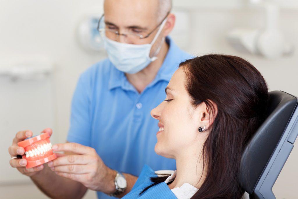 протезирование зубов по омс